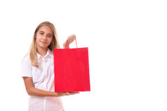 Shopping, sale, christmas and holiday-lovely young girl with red shopping bag,isolated Royalty Free Stock Photos
