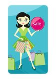 Shopping sale girl showing shopping bag with lable Stock Image