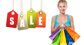 Shopping Sale. Happy woman is holding shopping bags. stock image