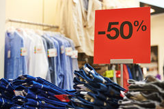 Shopping sale. seasonal half price discount on clothes. In apparel shop store Royalty Free Stock Images