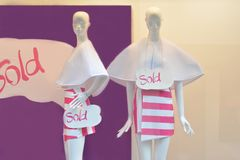 Shopping sale window display with two mannequins. With text Sold Stock Images
