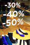 Shopping Sale. Women's shoes / -30, -40, -50% discount during winter sales in Annecy, France Royalty Free Stock Images