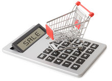 Shopping sales. Concept of shopping sales with a shopping cart on a calculator isolated on a white background Royalty Free Stock Photos