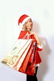 Shopping santa claus woman. Stock Images