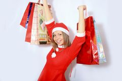 Shopping santa claus woman. Royalty Free Stock Image