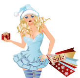 Shopping Santa girl with xmas gifts Stock Photo