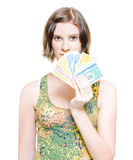 Shopping Savings And Retail Discounts. Isolated Studio Photograph Of A Perplexed And Stunned Young Female Holding A Fan Of Money In A Shopping Savings And Retail Royalty Free Stock Images
