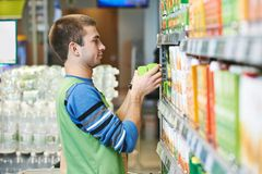Shopping seller in supermarket Stock Images