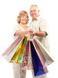 Shopping seniors. Happy shopping elderly people. Isolated over white background royalty free stock image