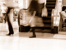 Shopping-sepia. Dynamic aspect in a supermarket-old style presentation of a modern life aspect Stock Image