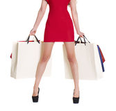 Shopping. female legs and color bags. Isolated on white background stock photos