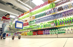 Shopping for shampoo at supermarket Royalty Free Stock Photo