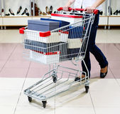 Shopping in shoe store Stock Images