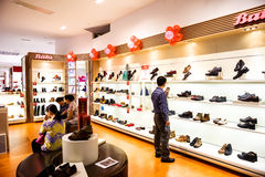 Shopping at shoe store Royalty Free Stock Image