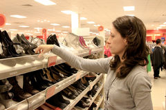 Shopping for shoes. Woman shopping in shoes store Stock Images