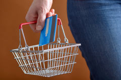 Shopping with shopping basket and credit card Stock Images