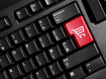 Shopping sign on the keyboard. Red button for internet shopping Stock Photo