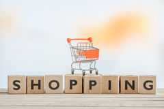 Shopping sign with a orange cart Royalty Free Stock Photography