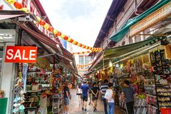 Shopping in Singapore Chinatown. SINGAPORE - SEPTEMBER 11, 2017: Shoppers visiting Chinatown for bargain souvenirs and authentic local food. The old Victorian stock photos
