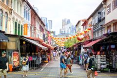 Shopping in Singapore Chinatown. SINGAPORE - SEPTEMBER 11, 2017: Shoppers visiting Chinatown for bargain souvenirs and authentic local food. The old Victorian stock image
