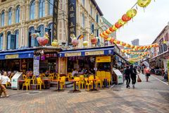 Shopping in Singapore Chinatown. SINGAPORE - SEPTEMBER 11, 2017: Shoppers visiting Chinatown for bargain souvenirs and authentic local food. The old Victorian stock photo