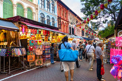 Shopping in Singapore Chinatown. Shoppers and tourists visit Singapore Chinatown for bargain souvenirs and authentic local food. The old, colorful Victorian royalty free stock photography