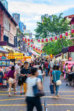 Shopping in Singapore Chinatown. Shoppers and tourists visit Singapore Chinatown for bargain souvenirs and authentic local food. The old, colorful Victorian stock photography