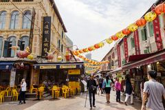 Shopping in Singapore Chinatown. SINGAPORE - SEPTEMBER 11, 2017: Shoppers visiting Chinatown for bargain souvenirs and authentic local food. The old Victorian royalty free stock image
