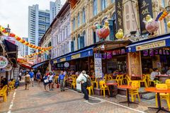 Shopping in Singapore Chinatown. SINGAPORE - SEPTEMBER 11, 2017: Shoppers visiting Chinatown for bargain souvenirs and authentic local food. The old Victorian stock images
