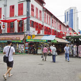 Shopping at Singapore's chinatown. SINGAPORE - JUN 22, 2011: Singapore's chinatown is a vibrant architectural shopping precinct popular with both residents and Royalty Free Stock Photos