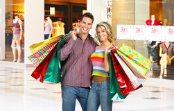 Shopping smiling couple Stock Photos