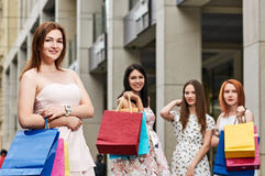 Shopping smiling young woman Stock Images
