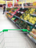 Shopping for some fruits and vegetables in supermarket. With shopping cart Royalty Free Stock Photos