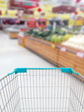 Shopping for some fruits and vegetables in supermarket with shop. Ping cart royalty free stock images