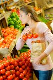 Shopping for some tomatoes. Bag royalty free stock photo