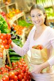 Shopping for some tomatoes. Bag royalty free stock photos