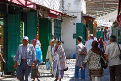Shopping at the souk in Tetouan, Morocco. Moroccans are buying their local products at the souk in Tetouan Royalty Free Stock Image