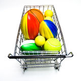 Shopping for Sports Toys. Toy sports balls in a metal shopping cart on white background stock image