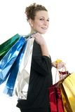 Shopping spree. Attractive Caucasian woman holding many shopping bags Royalty Free Stock Photo