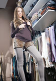 Shopping spree. Beautiful young brunette woman on a shopping spree showing off new clothes Royalty Free Stock Image
