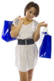 Shopping Spree. Young Asian female consumer on a holiday shopping spree Stock Photo