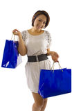 Shopping Spree. Young Asian female consumer on a holiday shopping spree Royalty Free Stock Photography