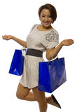 Shopping Spree. Young Asian female consumer on a holiday shopping spree royalty free stock photo