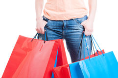 Shopping spree concept with female holding shopping bags. And wearing casual jeans isolated on white Stock Image