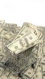 Shopping Spree - money windfall concept.   Cart full of money Royalty Free Stock Photos