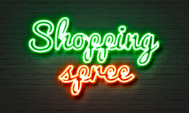 Shopping spree neon sign on brick wall background. Stock Image