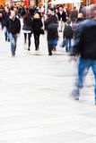 In the shopping street. Unrecognizable people walking on the shopping street Royalty Free Stock Image