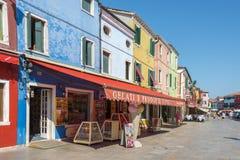 Shopping street Burano, Italy Stock Images