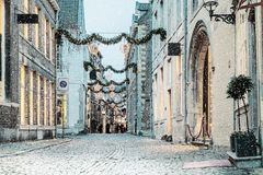 Shopping street with christmas lights and snowfall in the Dutch. City center of Maastricht, The Netherlands stock photos
