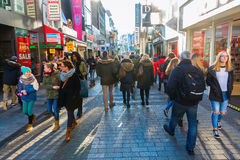 Shopping street Hohe Strasse in Cologne, Germany. Cologne, Germany - December 30, 2016: shopping street Hohe Strasse with unidentified people. It is a shopping royalty free stock images
